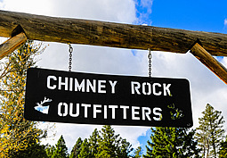 Chimney Rock Outfitters hunt camp sign